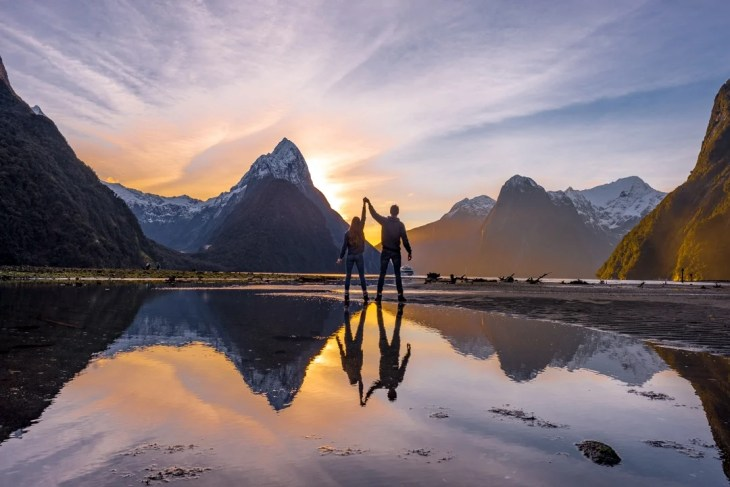 the sunset in milford sound
