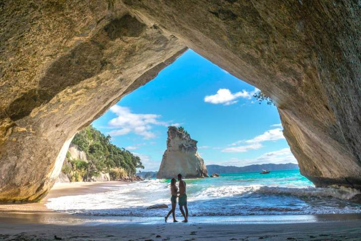 Cathedral cove is a stunning stop on a new Zealand road trip through the north island