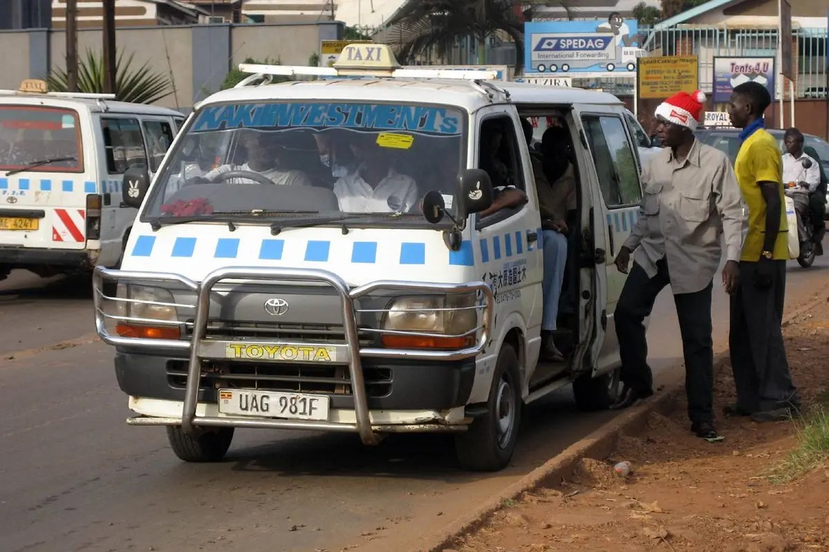 Minibus taxis in Uganda can pick up passengers by the roadside not designated for a stop: How To Travel in Uganda On a Budget