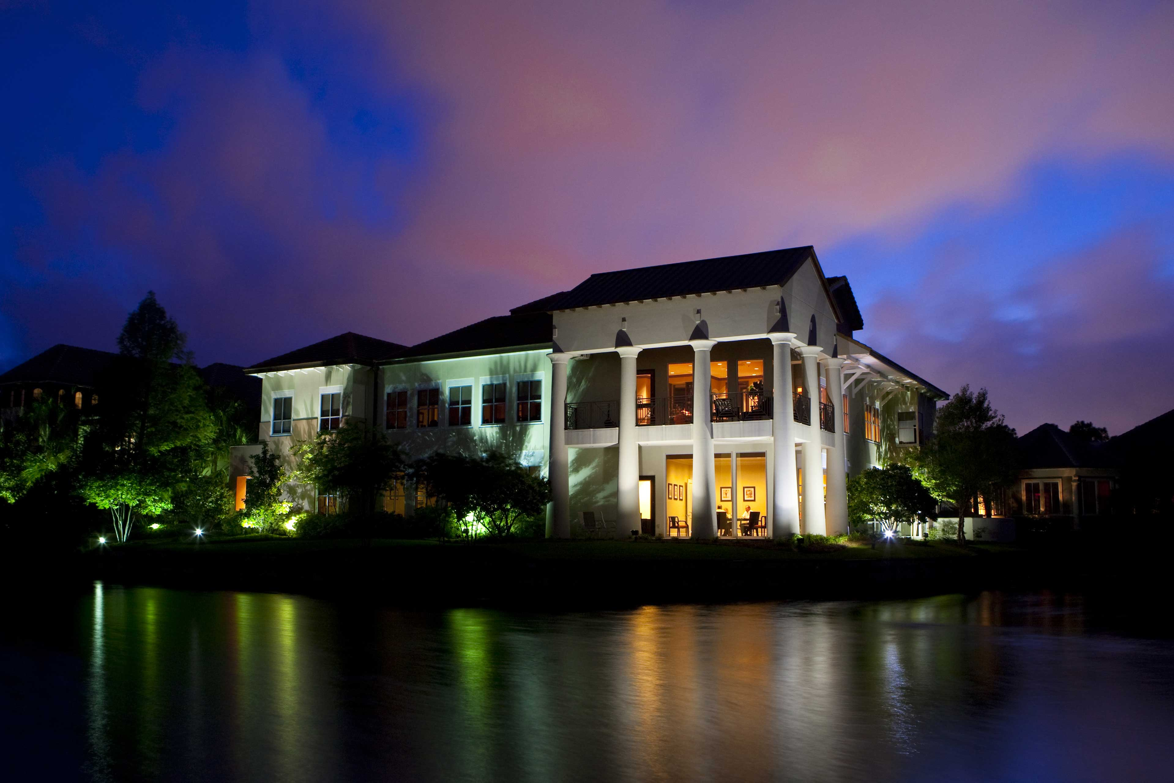 An exterior night photograph of the Matthews & Jones law office in Destin, Florida.