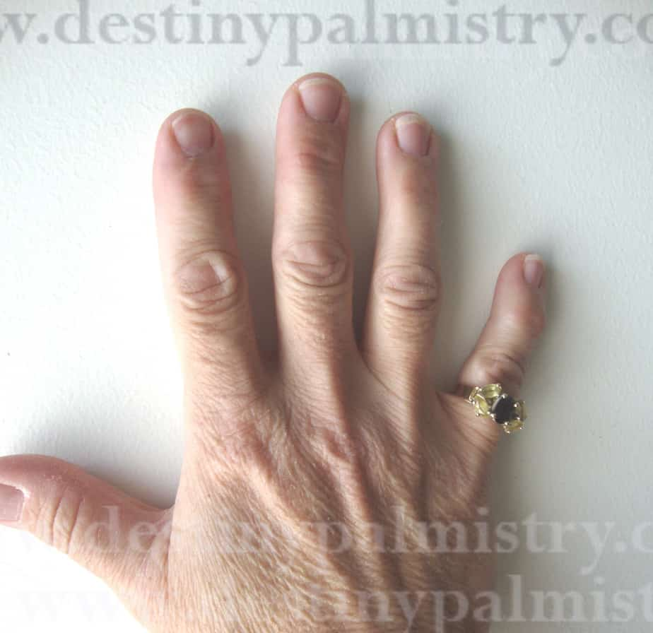 manly hands on a woman, palmistry lessons