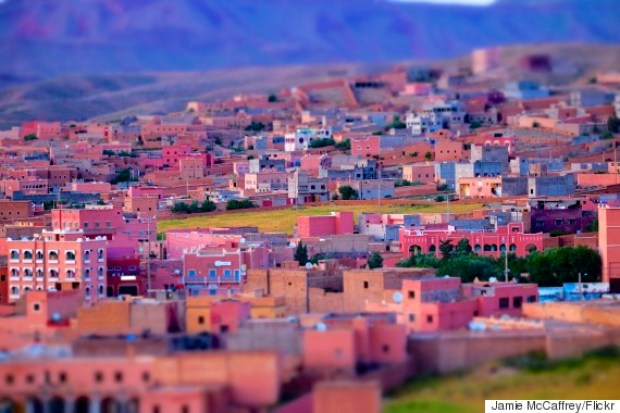 The town of Boumalne Dades, in the High Atlas Mountains of Morocco.  The majority of the buildings, in this town of ~11,000, had a distinctive pink hue which really gets accentuated in the light of dusk. i accidentally tweaked the camera and activated the miniature effect.  I was actually pleased with the surprise result.