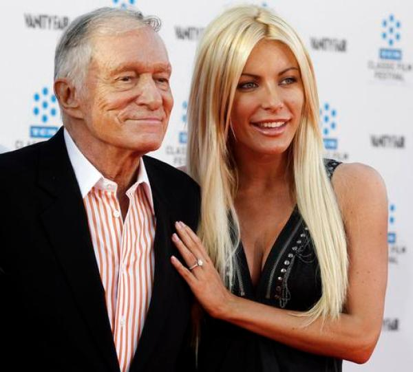Hugh Hefner and his fiancee, Playboy Playmate Crystal Harris, arrive at the opening night gala of the 2011 TCM Classic Film Festival featuring a screening of a restoration of 'An American In Paris' in Hollywood, California in this file photo from April 28, 2011. Harris and Hefner tied the knot December 31, 2012, after an aborted June 2011 attempt.  REUTERS/Fred Prouser/Files  (UNITED STATES - Tags: ENTERTAINMENT)