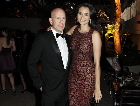Actor Bruce Willis (L) and his wife Emma Heming pose at The Weinstein Company and Relativity Media's after party for the 68th annual Golden Globe Awards in Beverly Hills, California January 16, 2011.  Reuters/Danny Moloshok  (UNITED STATES - Tags: ENTERTAINMENT PROFILE)  (GOLDENGLOBES-PARTIES)