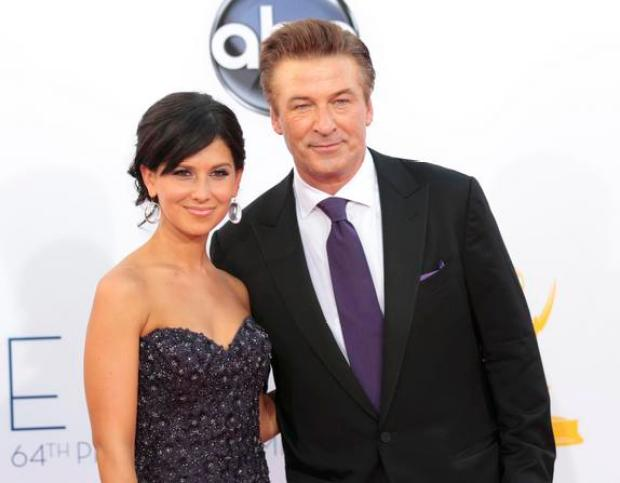 "Actor Alec Baldwin of the comedy series ""30 Rock"" and his wife Hilaria Thomas arrive at the 64th Primetime Emmy Awards in Los Angeles September 23, 2012.  REUTERS/Mario Anzuoni (UNITED STATES  Tags: ENTERTAINMENT) (EMMYS-ARRIVALS)"