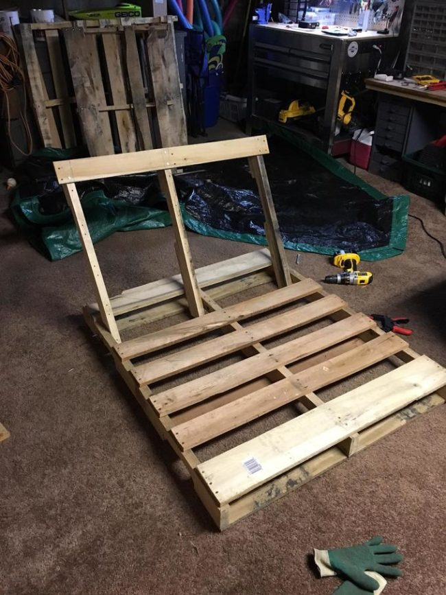 First, he took one of them apart completely. He then attached the main supports to another pallet at an angle. This would be the place you'd rest your back against.