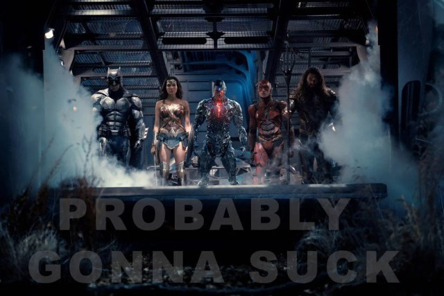 justice league heroes standing in a line with probably gonna suck superimposed