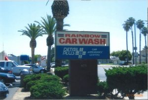 Sign and cars at Rainbow Carwash Detail Plus in Sunnyvale, California