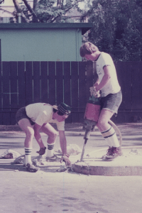 Old photo of two men building vacuum stations at Rainbow Carwash Detail Plus in Sunnyvale, California