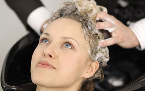 Woman having hair washed at beauty salon