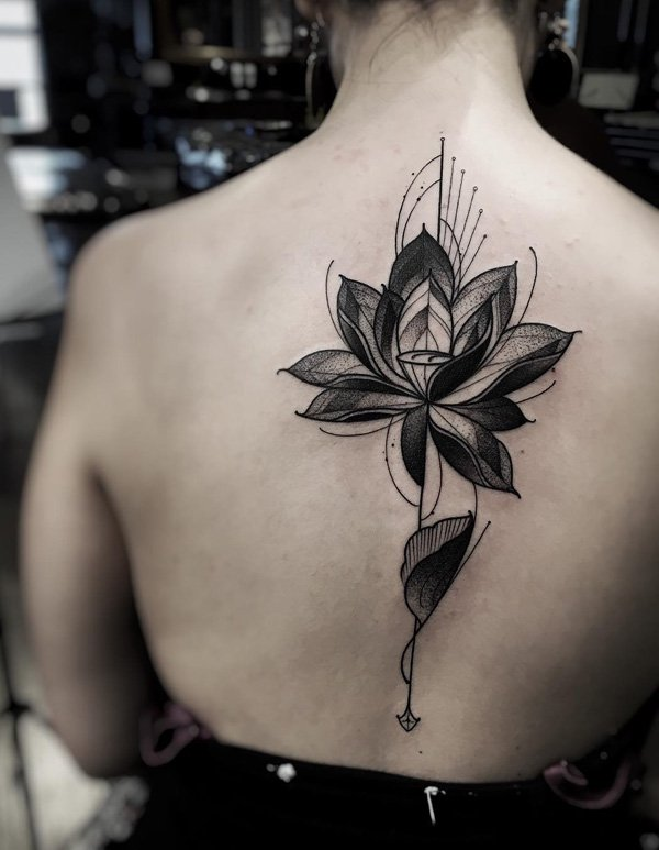 An abstract style lotus tattoo for a more unique design. A lotus flower has different meanings depending on its color but in general, it is associated with spiritual purity and enlightenment.