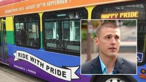 """CALGARY, THURSDAY AUGUST 27, 2015: Calgary Transit director Doug Morgan unveiled the agency's """"pride bus"""" on Thursday, August 27, 2015. The bus will be on streets for two weeks and will also make an appearance in next month's Pride Parade.  (Erika Stark/Calgary Herald)"""