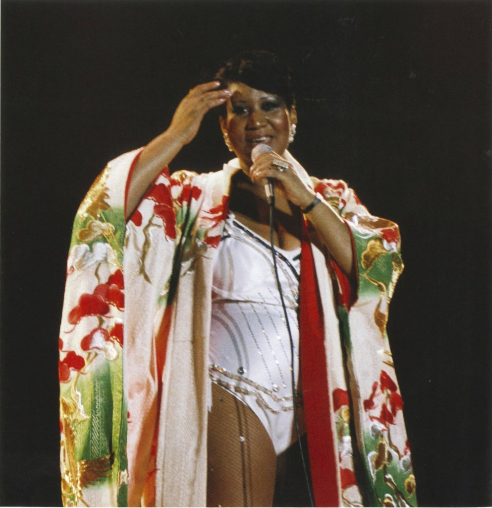 Aretha Franklin performing onstage in  a leotard and kimono in the 1980s. Photo from THE QUEEN NEXT DOOR, by Linda Solomon.
