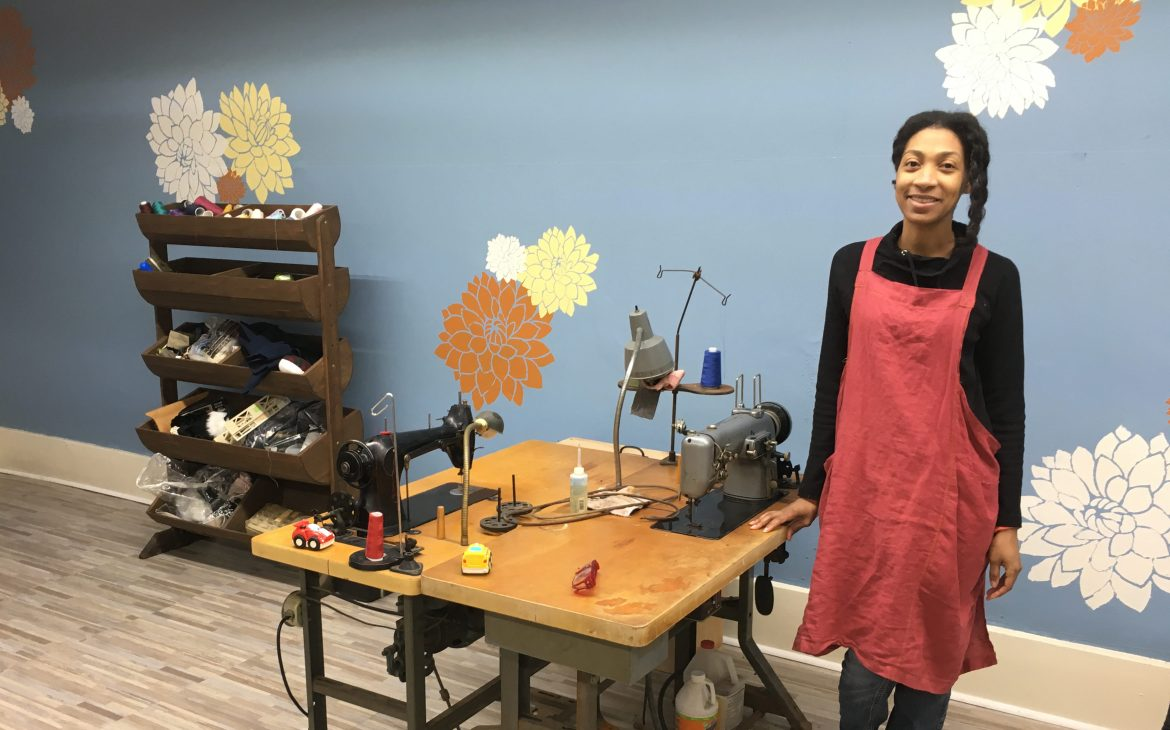Kristine Ferguson in her new Highland Park sewing and alterations shop, Backstitch