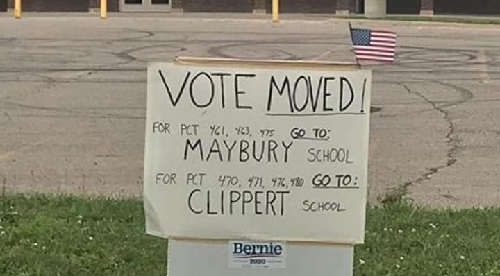 Sign indicating a polling location had moved in Detroit on Aug 4.