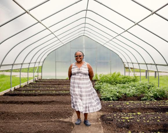 Jerry Hebron, one of the organizers of the Detroit Black Farmer Land Fund, stands in a greenhouse.