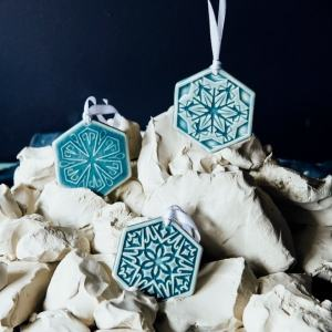 Pewabic Pottery, three different snowflake ornaments in shades of blue, these ornaments are apart of the 2020 annual Snowflake Trio set