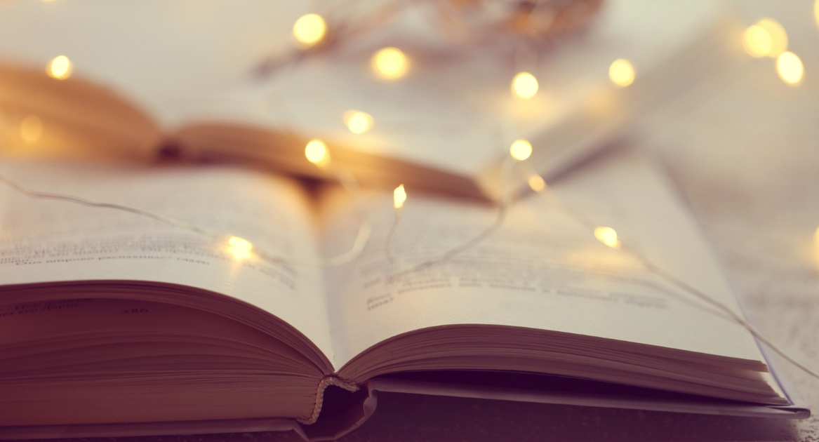 open book with fairy lights, illustrating story about best detroit and michigan books of 2020