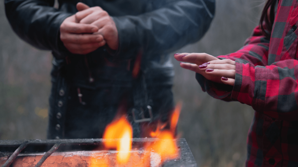 two people get warm at an outdoor fire, a pandemic winter entertaining essential