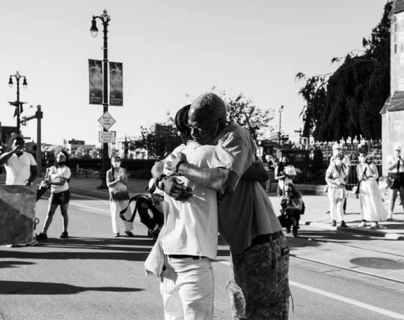 photo of people hugging at black lives matter protest in detroit, 2020, by rosa maria zamarron