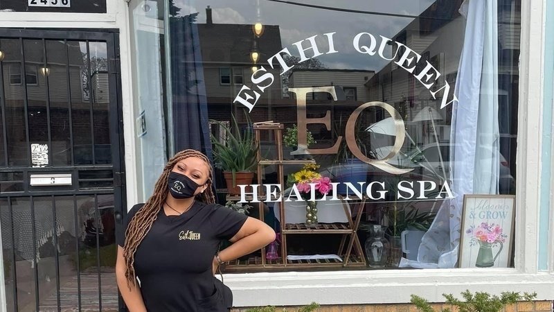 tiara boyd wearing a mask while standing in front of her hamtramck spa