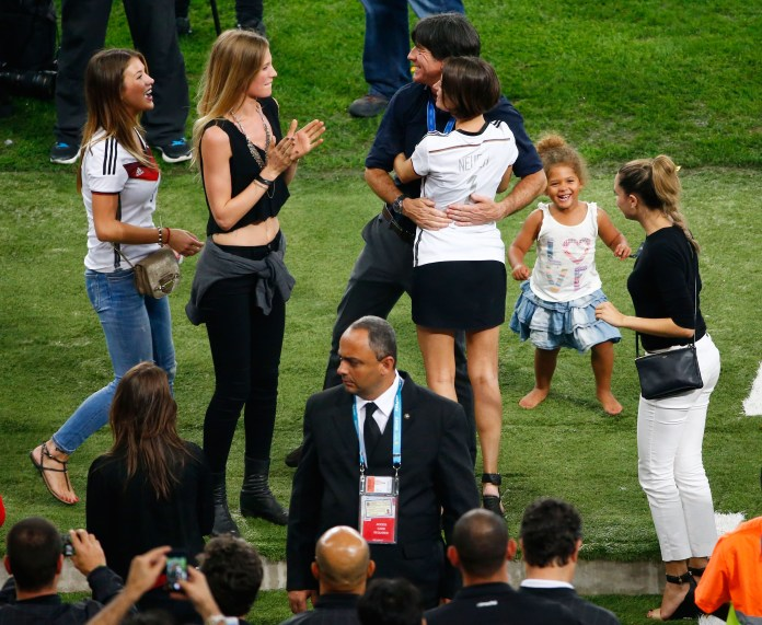 Head coach Joachim Loew hugs Kathrin Gilch, girlfriend of Manuel Neuer (Photo by Jamie Squire/Getty Images)