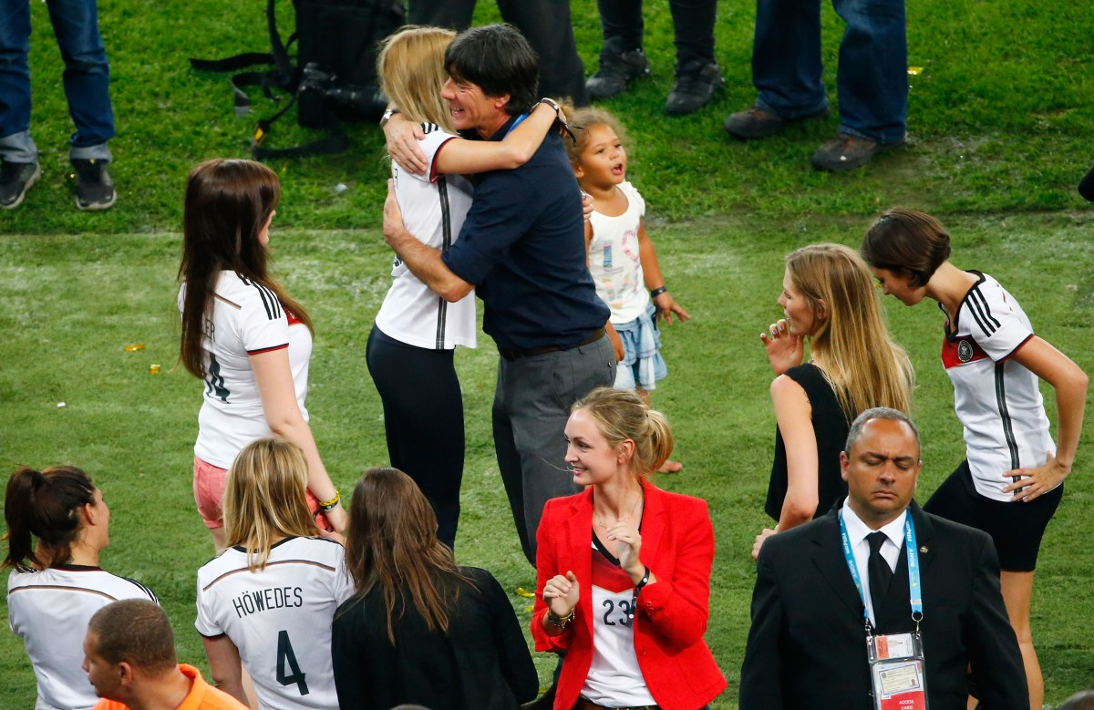Head coach Joachim Loew hugs Lisa Weidenfeller, wife of Roman Weidenfeller (Photo by Jamie Squire/Getty Images)