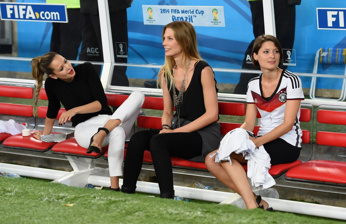(L-R) Mandy Capristo, girlfriend of Mesut Oezil, Sarah Brandner, girlfriend of Bastian Schweinsteiger of Germany and Kathrin Gilch girlfriend of Manuel Neuer (Photo by Matthias Hangst/Getty Images)