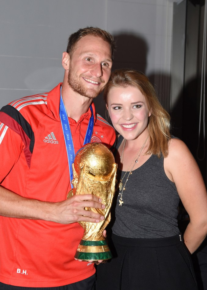 Benedikt Howedes of Germany and girlfriend Lisa Wesseler (Photo by Markus Gilliar - Pool/Getty Images)