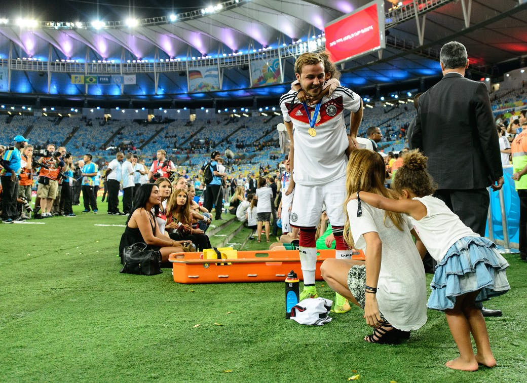 Mario Goetze of Germany and his girlfriend Ann-Kathrin Brommel (Photo by Matthias Hangst/Getty Images)