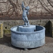 Branch Studio round fountain cistern with lead figure