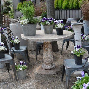 round_concrete_castiron_table