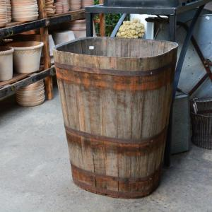 vintage French wood barrel with rusted steel bands