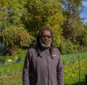 Malik Yakini stands inside D-Town Farm in Rouge Park on Detroit's West Side. Photo By John Bozick