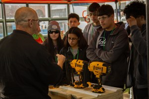 STUDENTS LEARN ABOUT VARIOUS TYPES OF DRILLS DURING THE SACHSE CONSTRUCTION ACADEMY.
