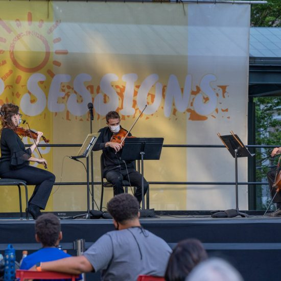 DSO ACTING CONCERTMASTER KIMBERLY KALOYANIDES KENNEDY, PRINCIPAL VIOLA ERIC NOWLIN, AND PRINCIPAL CELLO WEI YU PERFORM IN SOSNICK COURTYARD ON AUGUST 5, 2020