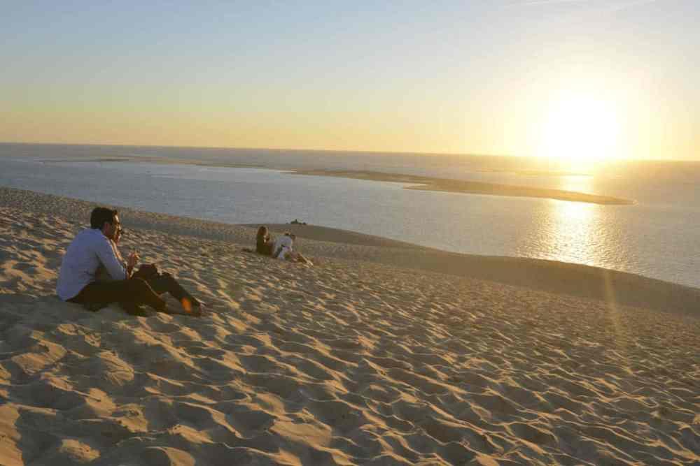 Solnedgang ved Dune du Pilat i Frankrike