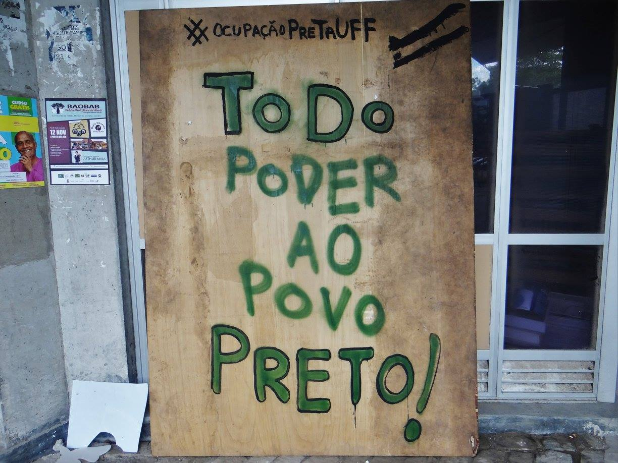 """A sign outside a building reads """"All Power To The Black People"""" (Photo from Ocupação Preta UFF)"""