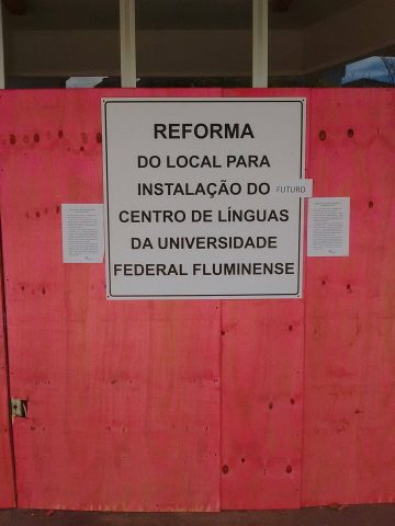 """A sign on the boarded-up exterior of Quilombo reads """"REFORM OF THE SITE FOR THE INSTALLATION OF THE (FUTURE) LANGUAGE CENTER OF UFF"""" (Photo courtesy of M. Cabral)"""