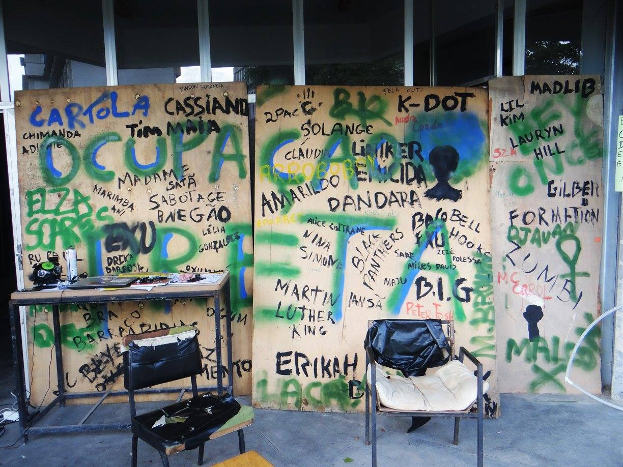 """""""Ocupação Preta"""" - """"Black Occupation"""" is painted on the entrance to Quilombo, along with the names of Black inspirational figures from Brazil, the US and beyond (Photo from Ocupação Preta UFF)"""