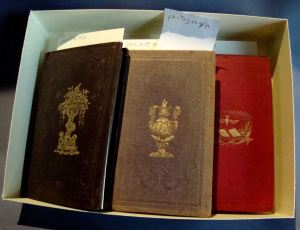 Collection of small volumes of consolation poetry.