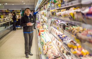 Staff at the refrigerated aisle