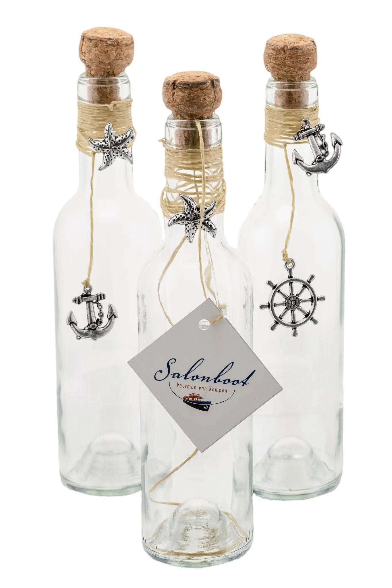 3 gedecoreerde flessen als kadoverpakking voor een waardebon van de Veerman van Kampen