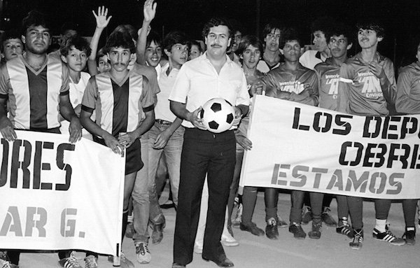 Escobar holding football in hand
