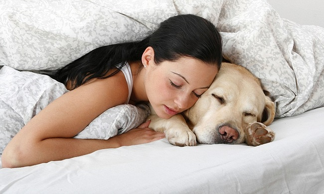 Girl sleeping with dog