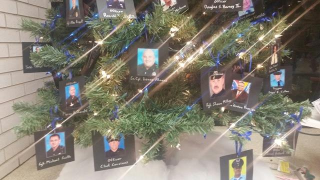 Christmas tree featuring fallen officers from the department