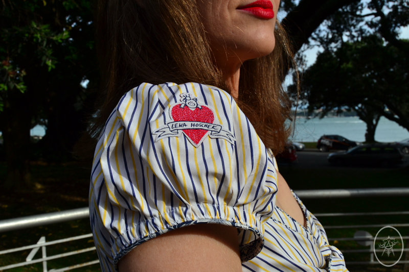 Signature red heart Lena Hoschek patch on striped puffy blouse sleeve