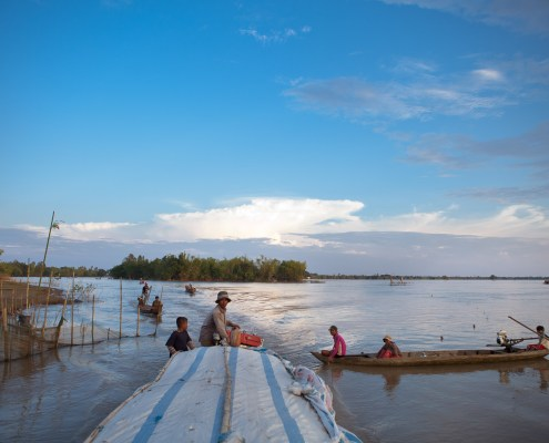 October 12, 2011 - Prey Veng Province. A boat carrying goods and passengers along a river inflated by the high water levels. © Nicolas Axelrod / Ruom Development