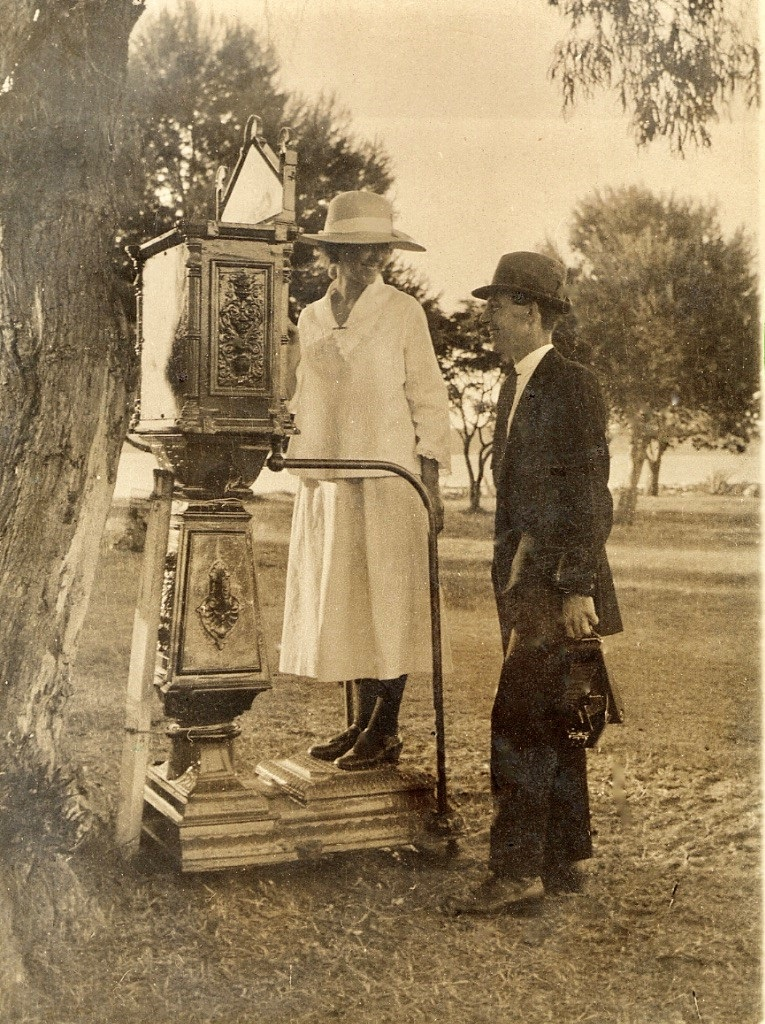 Queenie on the weighing machine, Norman with camera, c. 1920.