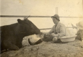 Mont and Bob with cow 1917
